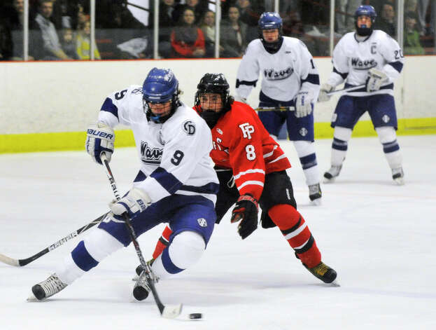 Darien's Dana Wensberg meets resistance from Fairfield Prep's David White during their game at Darien Ice Rink on Wednesday, Feb. 13, 2013. Fairfield Prep won, 6-0. Photo: Jason Rearick / The News-Times