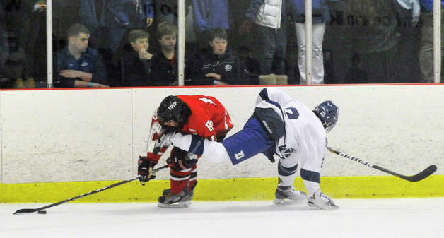 Fairfield Prep's Connor Henry collides with Darien's Nicholas Allam during their game at Darien Ice Rink on Wednesday, Feb. 13, 2013. Fairfield Prep won, 6-0. Photo: Jason Rearick / The News-Times