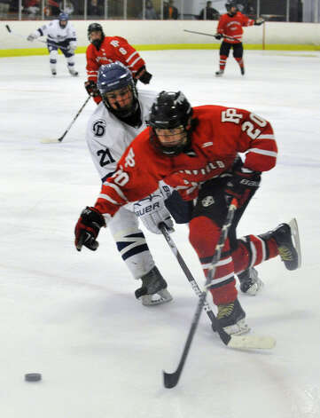 Fairfield Prep's Tim Edmonds meets resistance from Darien's Brendan Hathaway during their game at Darien Ice Rink on Wednesday, Feb. 13, 2013. Fairfield Prep won, 6-0. Photo: Jason Rearick / The News-Times