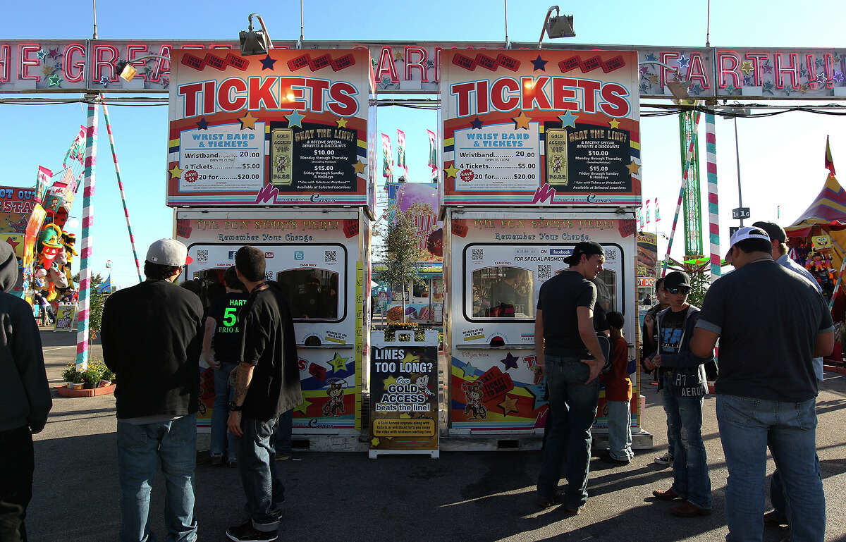 Carnival patrons line up to buy tickets at the 2013 San Antonio Stock Show and Rodeo on Wednesday, Feb. 13, 2013.