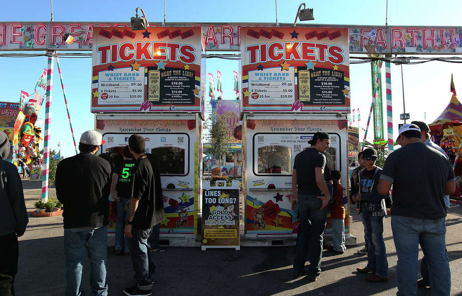 Carnival patrons line up to buy tickets at the 2013 San Antonio Stock Show and Rodeo on Wednesday, Feb. 13, 2013. Photo: Kin Man Hui, San Antonio Express-News / © 2012 San Antonio Express-News