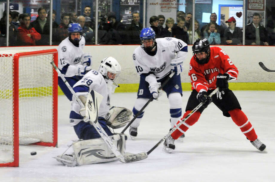 Fairfield Prep's Matt McKinney scores on Darien goalie Michael Collins during their game at Darien Ice Rink on Wednesday, Feb. 13, 2013. Fairfield Prep won, 6-0. Photo: Jason Rearick / The News-Times