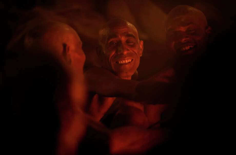 Hindu holy men undergo rituals to be initiated as Naga sadhus or naked Hindu holy men at the Maha Kumbh festival in Allahabad, India, Wednesday, Feb. 13, 2013. The significance of nakedness is that one will not have any worldly ties to material belongings, even something as simple as clothes. Rituals that transform selected holy men to Naga can only be done at the Kumbh festival. Photo: Saurabh Das, Associated Press / AP