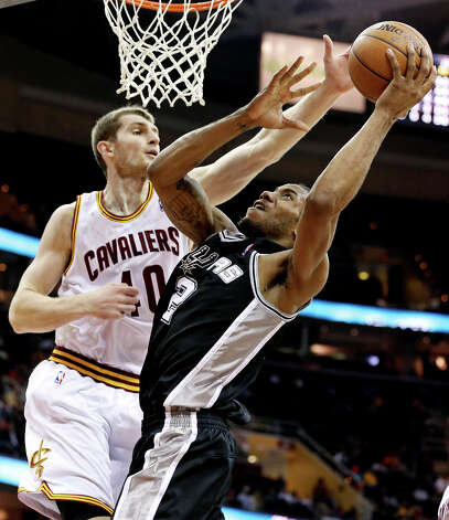 The Spurs' Kawhi Leonard drives to the basket against Cleveland's Tyler Zeller during first half action Wednesday, Feb. 13, 2013, at the Quicken Loans Arena in Cleveland, Ohio. Photo: Edward A. Ornelas, San Antonio Express-News / © 2013 San Antonio Express-News