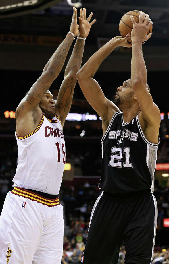 The Spurs' Tim Duncan shoots against Cleveland's Tristan Thompson during first half action Wednesday, Feb. 13, 2013, at the Quicken Loans Arena in Cleveland, Ohio. Photo: Edward A. Ornelas, San Antonio Express-News / © 2013 San Antonio Express-News