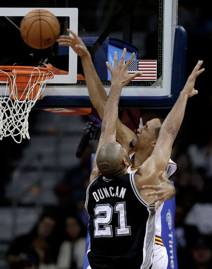 Cleveland Cavaliers' Shaun Livingston tries to dunk against San Antonio Spurs' Tim Duncan (21) during the second quarter of an NBA basketball game Wednesday, Feb. 13, 2013, in Cleveland. Livingston missed the shot. Photo: Tony Dejak, Associated Press / AP