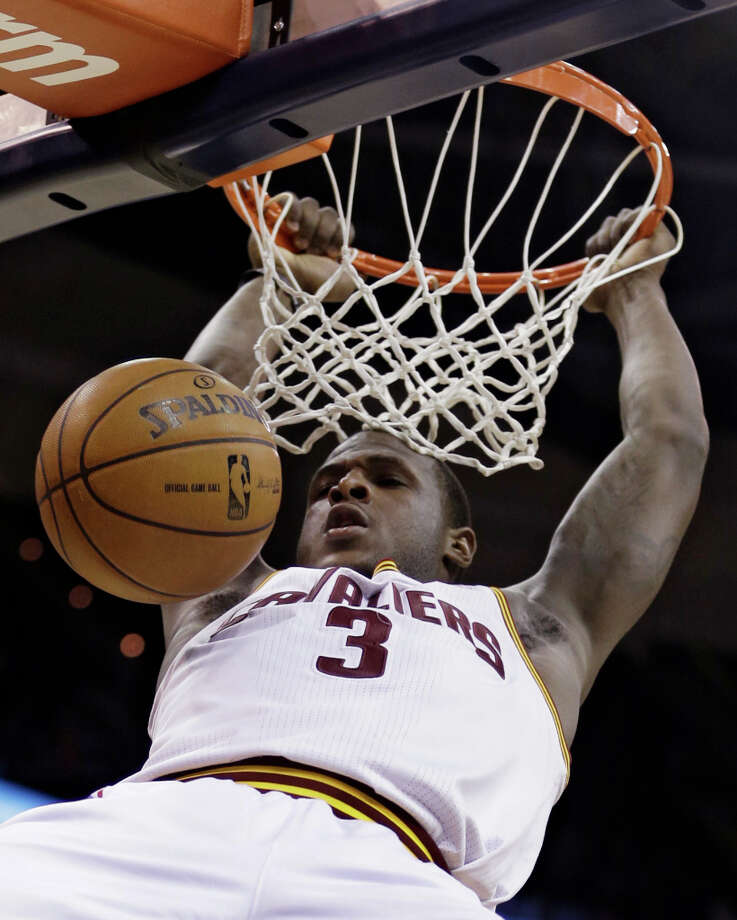 Cleveland Cavaliers' Dion Waiters dunks during the second quarter of an NBA basketball game against the San Antonio Spurs on Wednesday, Feb. 13, 2013, in Cleveland. Photo: Tony Dejak, Associated Press / AP