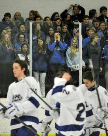 Darien fans scream in support of their team before the Blue Wave's game against Fairfield Prep at Darien Ice Rink on Wednesday, Feb. 13, 2013. Photo: Jason Rearick / The News-Times