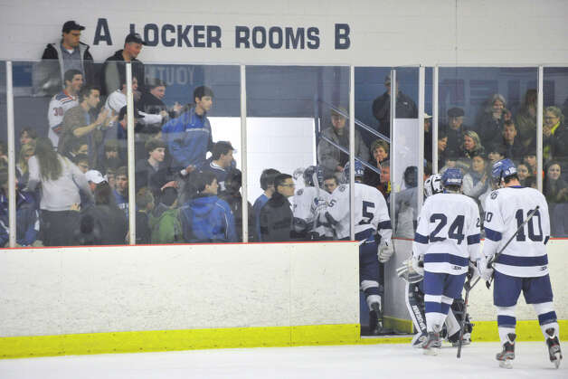 Darien fans cheer for their team as they exit the ice in between periods during the Blue Wave's game against Fairfield Prep at Darien Ice Rink on Wednesday, Feb. 13, 2013. Photo: Jason Rearick / The News-Times
