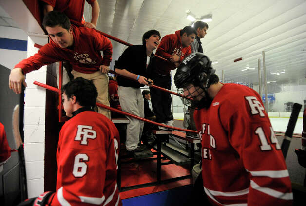 Fairfield Prep fans congratulate the players after the second period of their game against Darien at Darien Ice Rink on Wednesday, Feb. 13, 2013. Photo: Jason Rearick / The News-Times