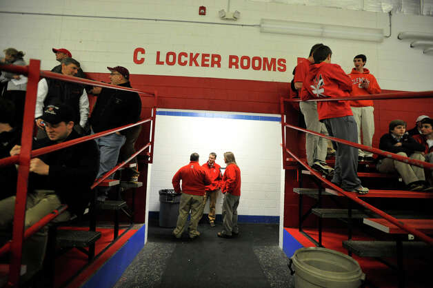 Fairfield Prep coaches talk outside their team's locker room between the second and third periods during their game against Darien at Darien Ice Rink on Wednesday, Feb. 13, 2013. Photo: Jason Rearick / The News-Times