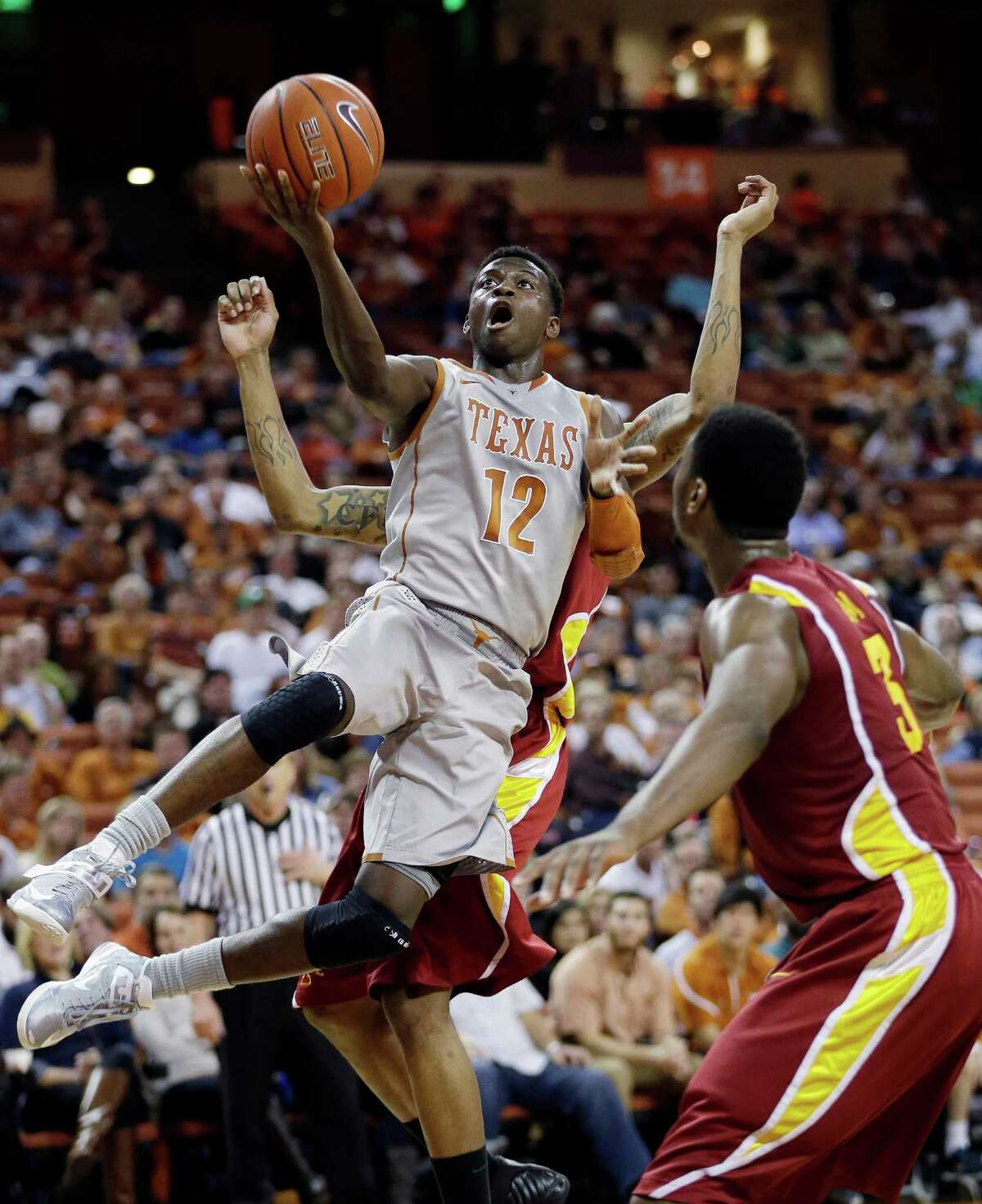 Texas' Myck Kabongo (12) shoots over Iowa State's Melvin Ejim (3) during the first half of an NCAA college basketball game, Wednesday, Feb. 13, 2013, in Austin, Texas. Kabongo returned for his first game of the season after a 23-game NCAA suspension. (AP Photo/Eric Gay)