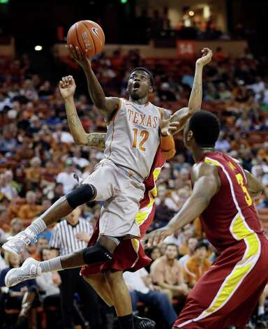 Texas' Myck Kabongo (12) shoots over Iowa State's Melvin Ejim (3) during the first half of an NCAA college basketball game, Wednesday, Feb. 13, 2013, in Austin, Texas. Kabongo returned for his first game of the season after a 23-game NCAA suspension. (AP Photo/Eric Gay) Photo: Eric Gay, Associated Press / AP