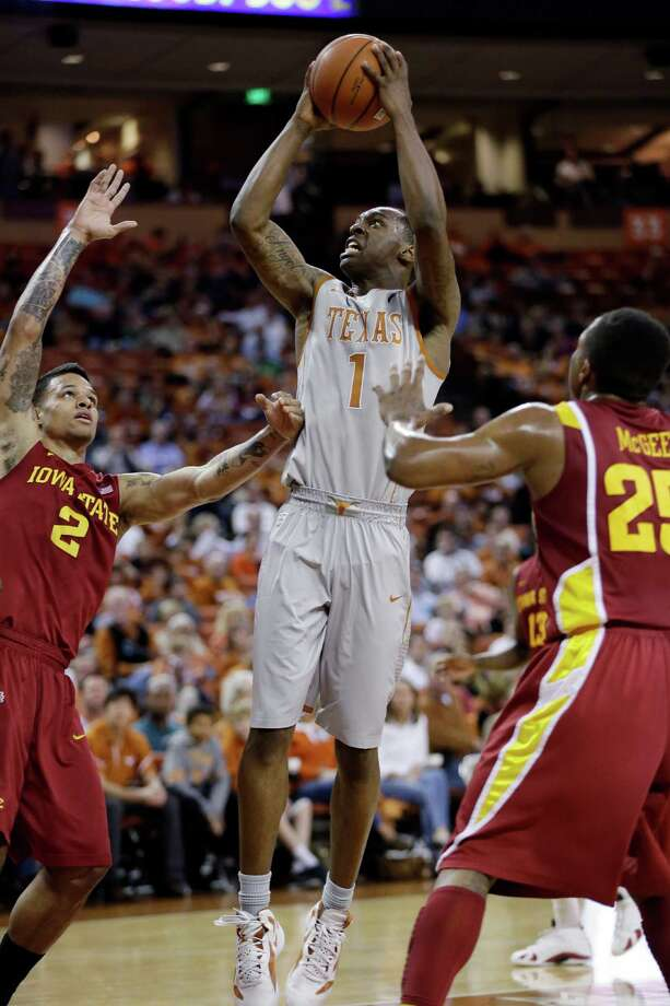 Texas' Sheldon McClellan (1) shoots over Iowa State's Chris Babb (2) and Tyrus McGee (25) during the first half of an NCAA college basketball game, Wednesday, Feb. 13, 2013, in Austin, Texas. (AP Photo/Eric Gay) Photo: Eric Gay, Associated Press / AP