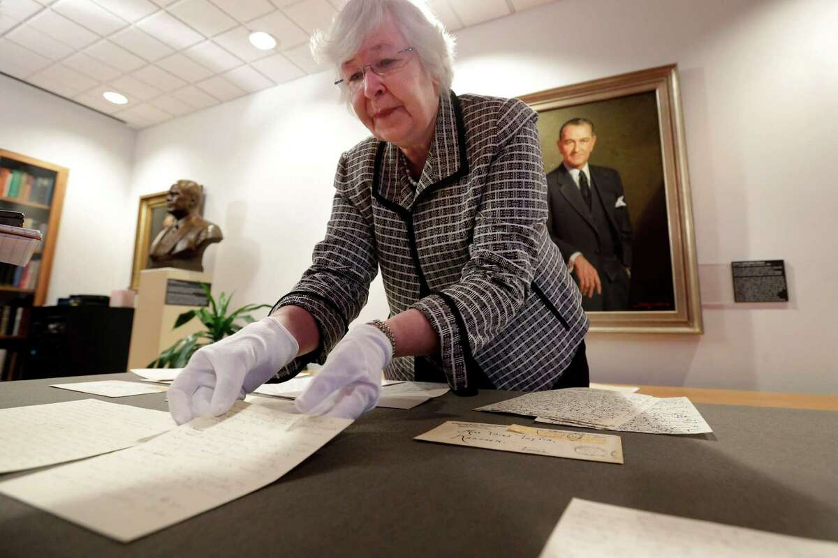 Archivist Claudia Anderson handles some of the love letters exchanged between Lyndon Johnson, then a 26-year-old congressional aide, and Claudia Alta