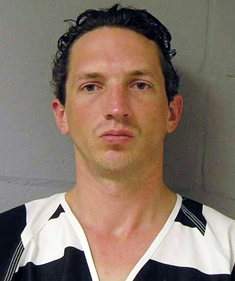 """FILE - This undated file photo provided by the FBI shows Israel Keyes. The confessed serial killer was mistakenly issued a razor before he committed suicide, according to a report released Wednesday, Feb. 13, 2013, by the Alaska Department of Corrections that also said """"it appears that razor was not retrieved.""""  Keyes' body was found in his jail cell on Dec. 2, months before he was to have gone on trial for the 2012 slaying of 18-year-old Anchorage barista Samantha Koenig. (AP Photo/FBI, File) Photo: Uncredited"""