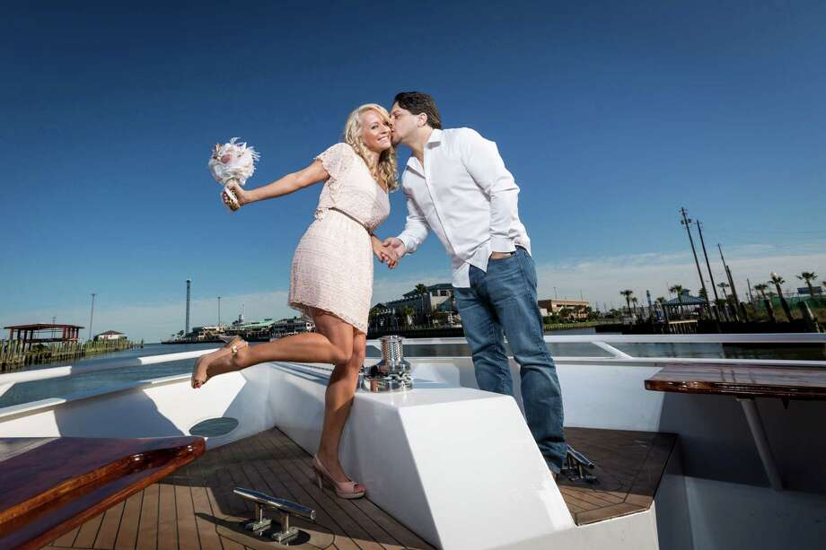 Summer Gallagher, left, and her fiance Luke Cash stand aboard the Boardwalk FantaSea yacht where they will be married on Valentine's Day in Kemah.  The couple and around 30 family members had to ditch their Cozumel dream wedding after being notified the Carnival cruise ship Triumph was disabled at sea due to a fire. Photo: Michael Paulsen, Houston Chronicle / © 2013 Houston Chronicle