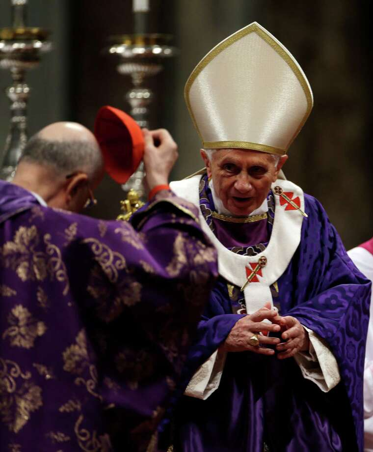 "Vatican Secretary of State Cardinal Tarcisio Bertone takes off his skull cap after he delivered a speech to Pope Benedict XVI at the end of the Ash Wednesday mass in St. Peter's Basilica at the Vatican, Wednesday, Feb. 13, 2013.  Ash Wednesday marks the beginning of Lent, a solemn period of 40 days of prayer and self-denial leading up to Easter. Pope Benedict XVI told thousands of faithful Wednesday that he was resigning for ""the good of the church"", an extraordinary scene of a pope explaining himself to his flock that unfolded in his first appearance since dropping the bombshell announcement. (AP Photo/Gregorio Borgia) Photo: Gregorio Borgia / AP"