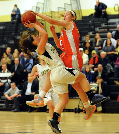 Danbury's #5 Rachel Gartner blocks Trumbull's #20 Lauren Hyde as she attempts a shot, during girls basketball action in Trumbull, Conn. on Wednesday February 13, 2013. Photo: Christian Abraham / Connecticut Post