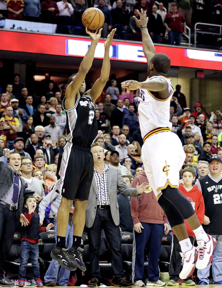 San Antonio Spurs' Kawhi Leonard shoots the game winning 3-pointer against Cleveland's Dion Waiters late in second half action Wednesday, Feb. 13, 2013, at the Quicken Loans Arena in Cleveland, Ohio. The Spurs won 96-95. Photo: Edward A. Ornelas, San Antonio Express-News / © 2013 San Antonio Express-News