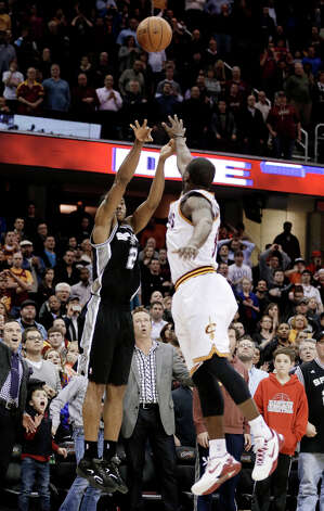 San Antonio Spurs' Kawhi Leonard (2) shoots the game-winning basket over Cleveland Cavaliers' Dion Waiters (3) during an NBA basketball game Wednesday, Feb. 13, 2013, in Cleveland. San Antonio won 96-95. Photo: Tony Dejak, Associated Press / AP