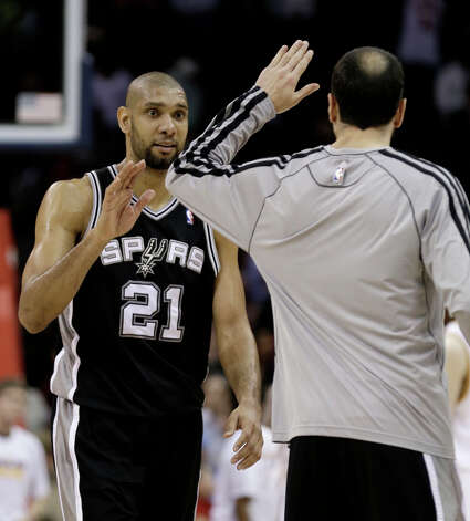 San Antonio Spurs' Tim Duncan, left, is congratulated by Manu Ginobili after the Spurs defeated the Cavaliers 96-95 in an NBA basketball game Wednesday, Feb. 13, 2013, in Cleveland. Photo: Tony Dejak, Associated Press / AP