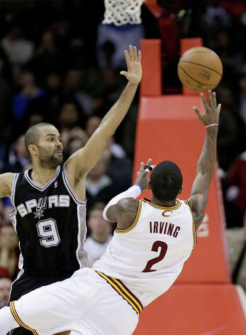Cleveland Cavaliers' Kyrie Irving (2) misses a shot at the close of the game as San Antonio Spurs' Tony Parker (9) defends late in the fourth quarter of an NBA basketball game Wednesday, Feb. 13, 2013, in Cleveland. San Antonio won 96-95. Photo: Tony Dejak, Associated Press / AP
