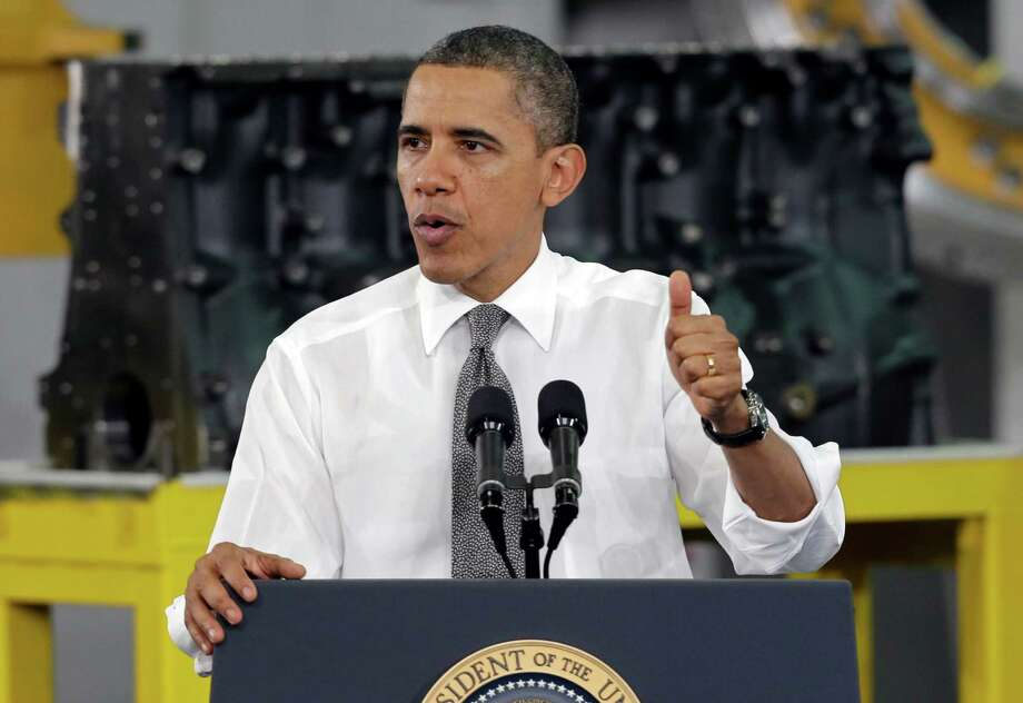 President Barack Obama speaks to workers and guests at the Linamar Corporation plant in Arden, N.C., Wednesday, Feb. 13, 2013, as he travels after delivering his State of the Union address Tuesday. (AP Photo/Chuck Burton) Photo: Chuck Burton