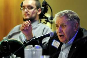 Paul Richter, right, speaks as part of a panel about the need to reinstate spinal cord injury research state funding on Wednesday, Feb. 13, 2013, at the Empire State Convention Center in Albany, N.Y. At left is Keith Gurgui. (Cindy Schultz / Times Union)