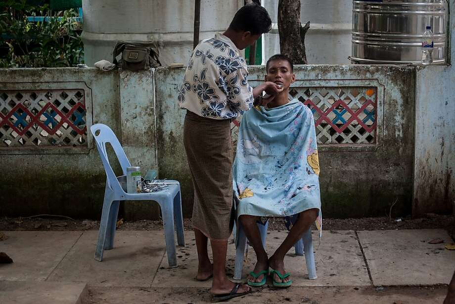 YANGON, BURMA - FEBRUARY 13: A patient living with HIV-AIDS receives a shave and a haircut outside the HIV-AIDS Care and Prevention center on February 13, 2013 in Yangon, Burma. The hospice assists 180 men, women and children suffering from AIDS and is funded by the National League for Democracy (NLD) As the country goes through sweeping political and economic reforms, many are hopeful that after decades of neglect the healthcare system will also benefit from the changes. Although health budgets have increased the state health system is still underfunded and struggles to provide basic healthcare as well as essential medicines for treating HIV, Malaria and TB. With sanctions being lifted it is hopeful that again the flow of medical equipment, medicines and the presence of NGO's will increase.  (Photo by Chris McGrath/Getty Images) *** BESTPIX *** Photo: Chris McGrath, Getty Images