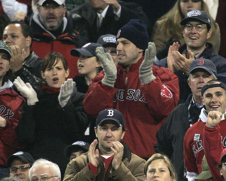 Actors Jennifer Garner and Ben Affleck sit at Game 2 of the World Series between the Red Sox and St.