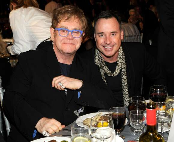 Elton John and filmmaker David Furnish started dating in 1993 and, in 1995, entered into a civil partnership. They now have two sons, Zachary and Elijah. Photo: Kevin Mazur, WireImage / 2013 Kevin Mazur