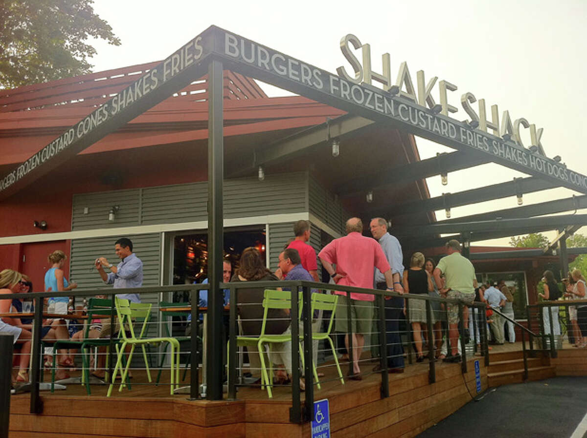 Patrons relax on the patio at Shake Shack at 1849 Post Road East in Westport, Conn., on Tuesday, July 19, 2011.