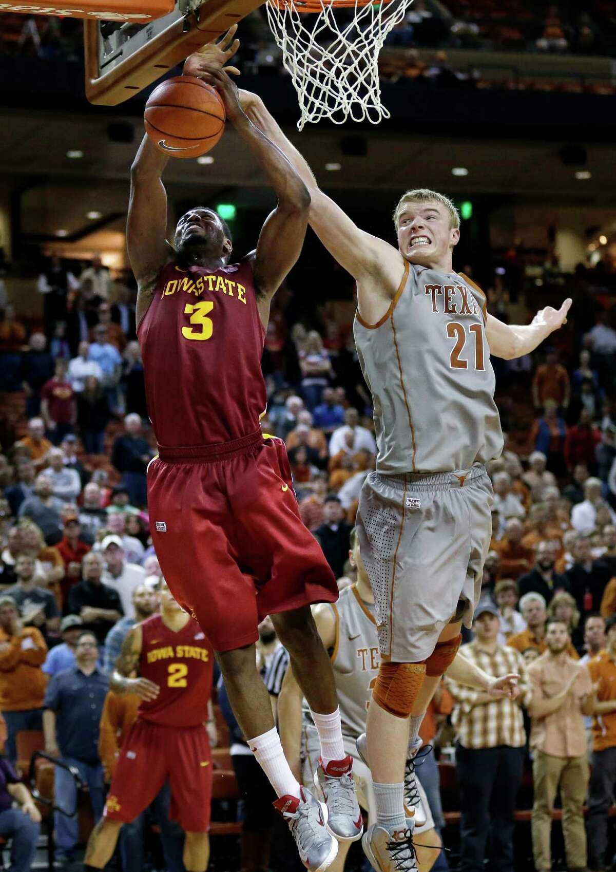 Texas' Connor Lammert (21) blocks Iowa State's Melvin Ejim (3) during overtime of an NCAA college basketball game, Wednesday, Feb. 13, 2013, in Austin, Texas. Texas won 89-86 in double overtime. (AP Photo/Eric Gay)