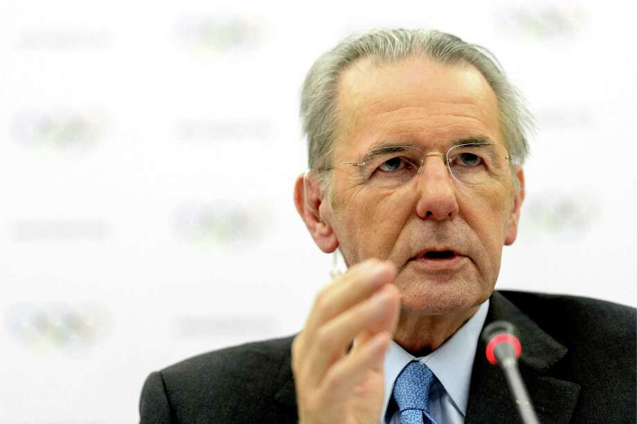 """International Olympic Committee, IOC, President Jacques Rogge   speaks during a press conference after the last day of the executive board's meeting, in Lausanne, Switzerland, Wednesday, Feb. 13, 2013. IOC President Jacques Rogge has backed Pat McQuaid to lead the International Cycling Union in its ongoing dispute with the World Anti-Doping Agency.  Rogge tells reporters the Olympic body does not currently plan on intervening in a row fuelled by the Lance Armstrong doping case.  Asked for an opinion on cycling's leadership, Rogge says """"we have confidence in Mr. McQuaid as president of the UCI.""""  (AP Photo/Keystone,/Laurent Gillieron) Photo: Laurent Gillieron"""