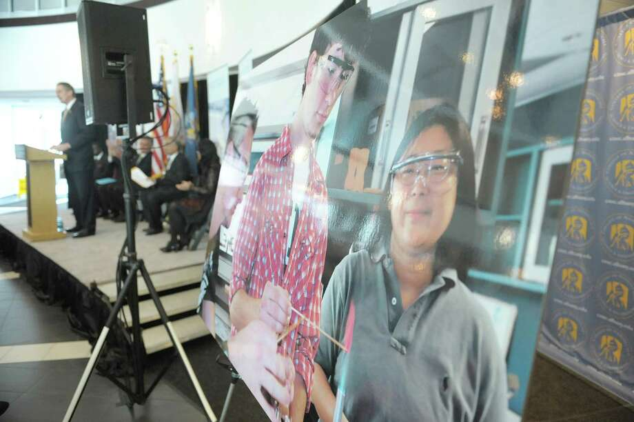 A large photograph of Tech Valley High School Students is on display as York State Lieutenant Governor Robert Duffy, background, addresses those gathered for an event at the College of Nanoscale Science and Engineering on Wednesday, Feb. 13, 2013 in Albany, NY.  It was announced at the event that Tech Valley High School, currently located in East Greenbush, would be moving into space at CNSE's Albany NanoTech Complex. (Paul Buckowski / Times Union) Photo: Paul Buckowski  / 00021167A