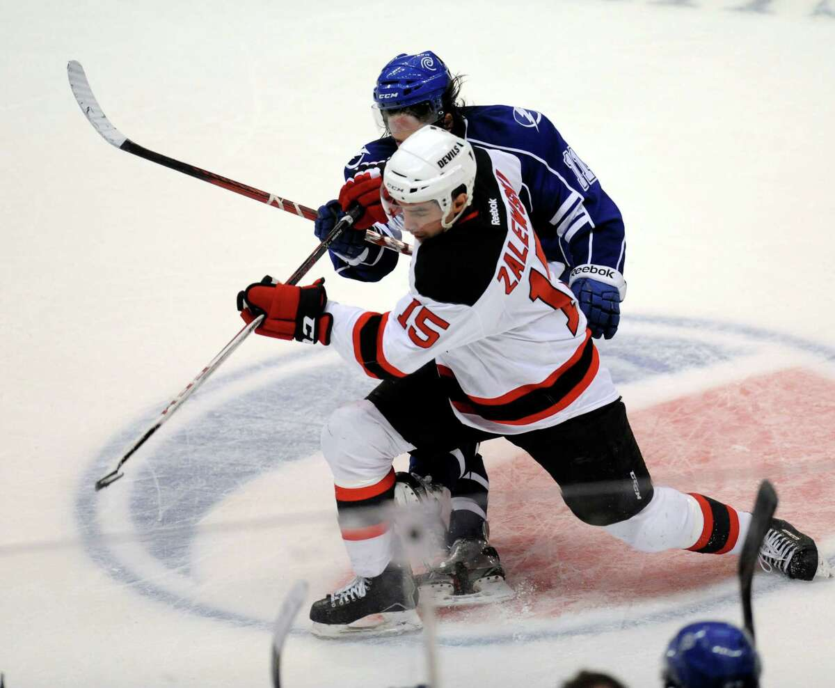 Albany Devils' Steve Zalewski (15) checks Syracuse Crunch's Mike Angelidis (11) during the first period of their AHL hockey game, Wednesday, Feb. 13, 2013, in Albany, N.Y. (Hans Pennink / Special to the Times Union) Pro Sports