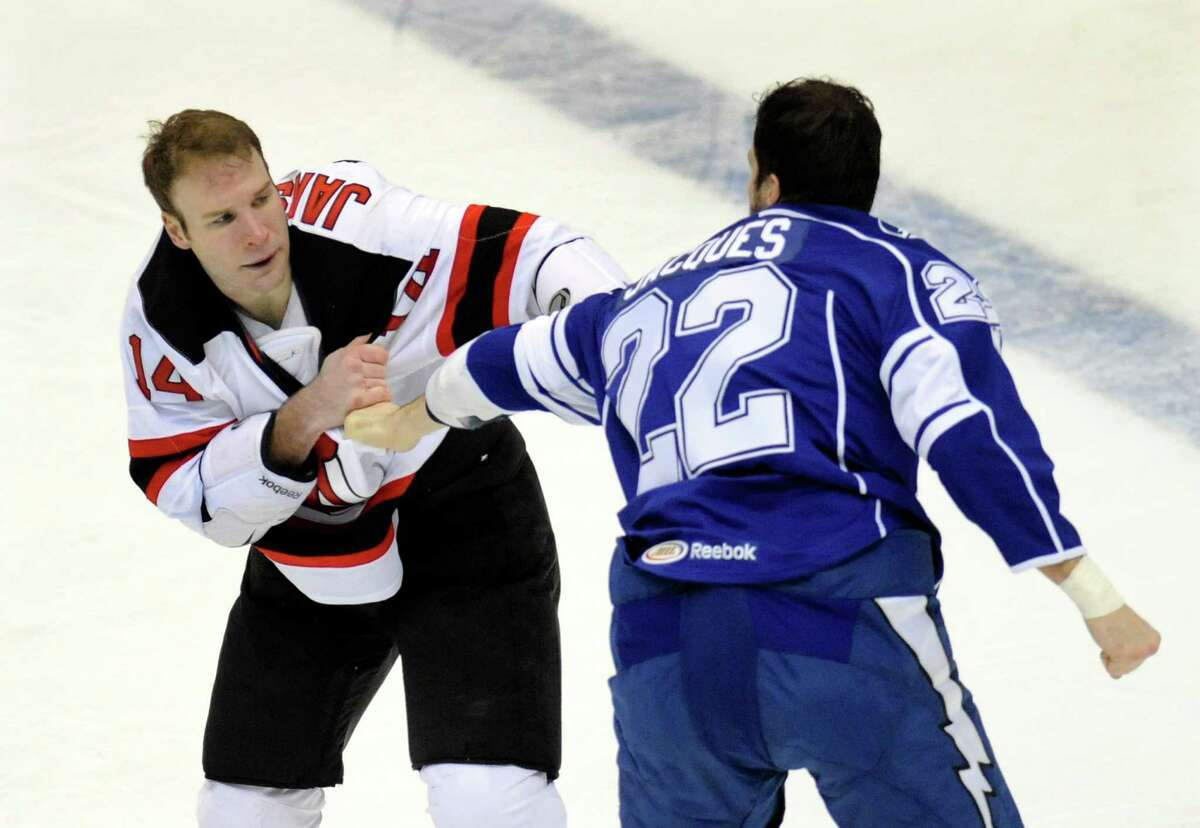 Albany Devils' Cam Janssen (14) fights with Syracuse Crunch's Jean-Francois Jacques (22) during the first period of their AHL hockey game, Wednesday, Feb. 13, 2013, in Albany, N.Y. (Hans Pennink / Special to the Times Union) Pro Sports