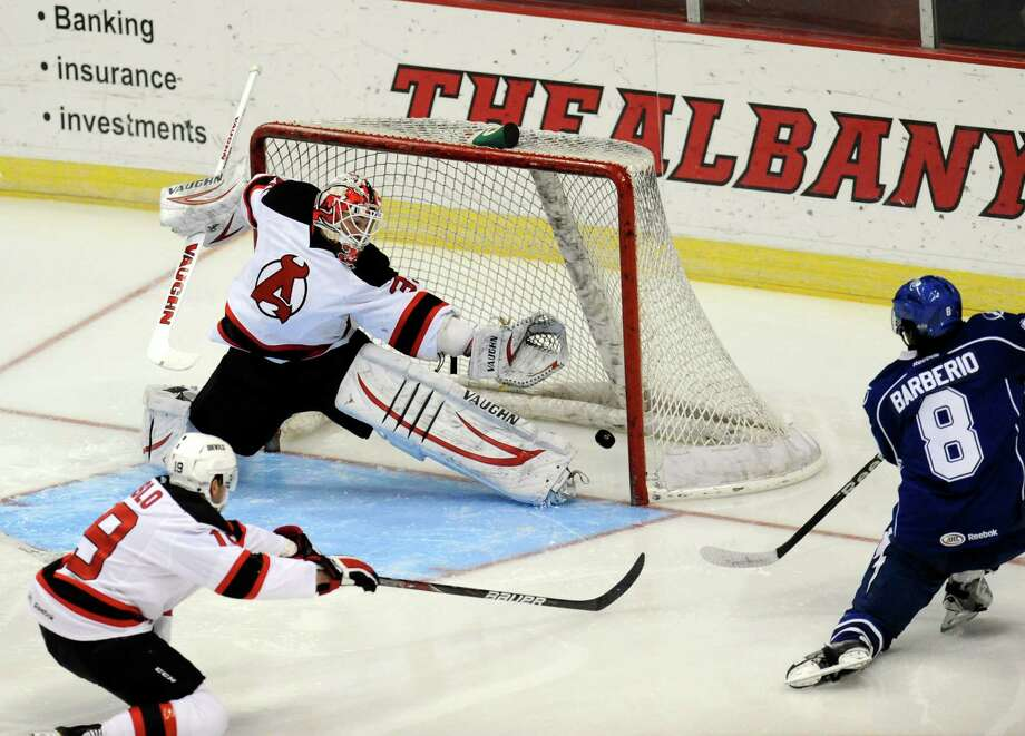 Syracuse Crunch's Mark Barberio (8) scores on Albany Devils' Goalie Keith Kinkaid (35) during the first period of their AHL hockey game, Wednesday, Feb. 13, 2013, in Albany, N.Y. (Hans Pennink / Special to the Times Union) Pro Sports Photo: Hans Pennink / Hans Pennink