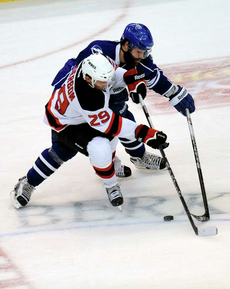 Albany Devils' Matt Anderson (29) is defended by Syracuse Crunch's Alex Hutchings (11) during the second period of their AHL hockey game, Wednesday, Feb. 13, 2013, in Albany, N.Y. (Hans Pennink / Special to the Times Union) Pro Sports Photo: Hans Pennink / Hans Pennink