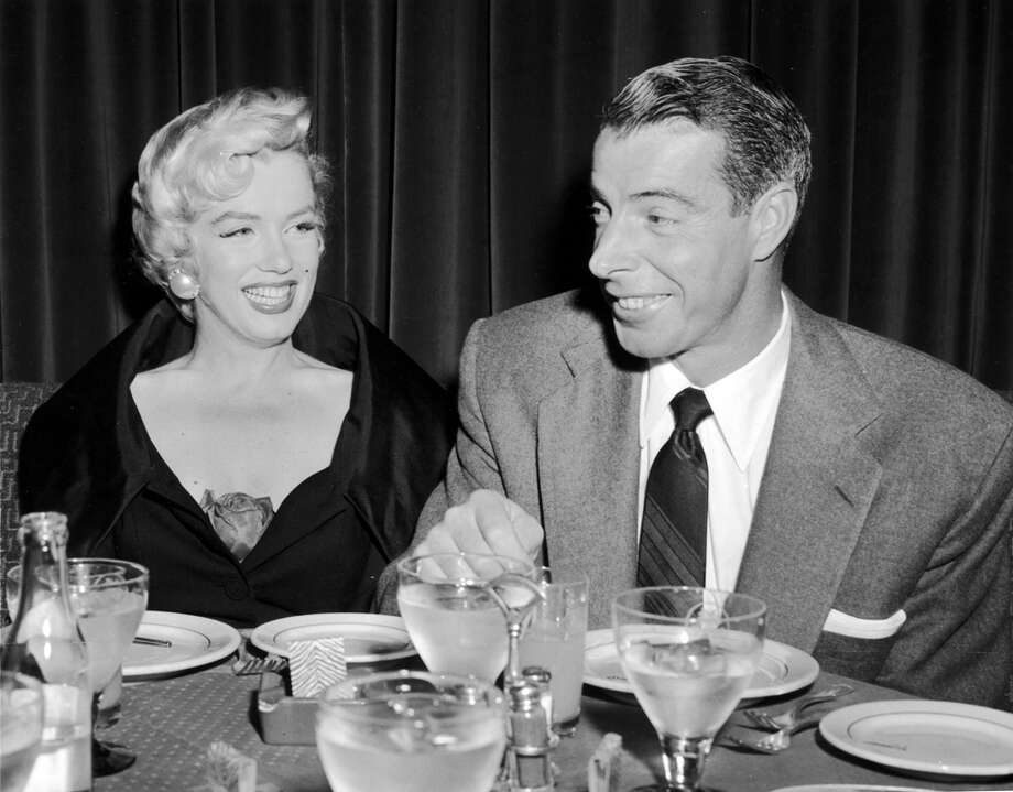 "Baseball legend Joe Dimaggio met Marilyn Monroe on a kind-of blind date in 1952. She was expecting a flashy New York sports type, People magazine reported in 1996, ""and instead I met this reserved guy who didn't make a pass at me right away. He treated me like something special."" They married two years later at San Francisco's city hall. But he became furious at her famous skirt-blowing scene in ""The Seven Year Itch,"" and their rocky relationship ended nine months after their wedding. However, they reconnected after her marriage to playwright Arthur Miller ended in 1961 and there was speculation the couple would remarry. But she died of a barbiturate overdose in 1962. Dimaggio arranged Monroe's funeral, prohibiting the Kennedys, Frank Sinatra and other Hollywood elite. He also had roses sent to her crypt for two decades after her death, and some accounts say he stopped only after reporters found out. He didn't talk publicly about their time together, and died in 1999. Photo: Getty Images"