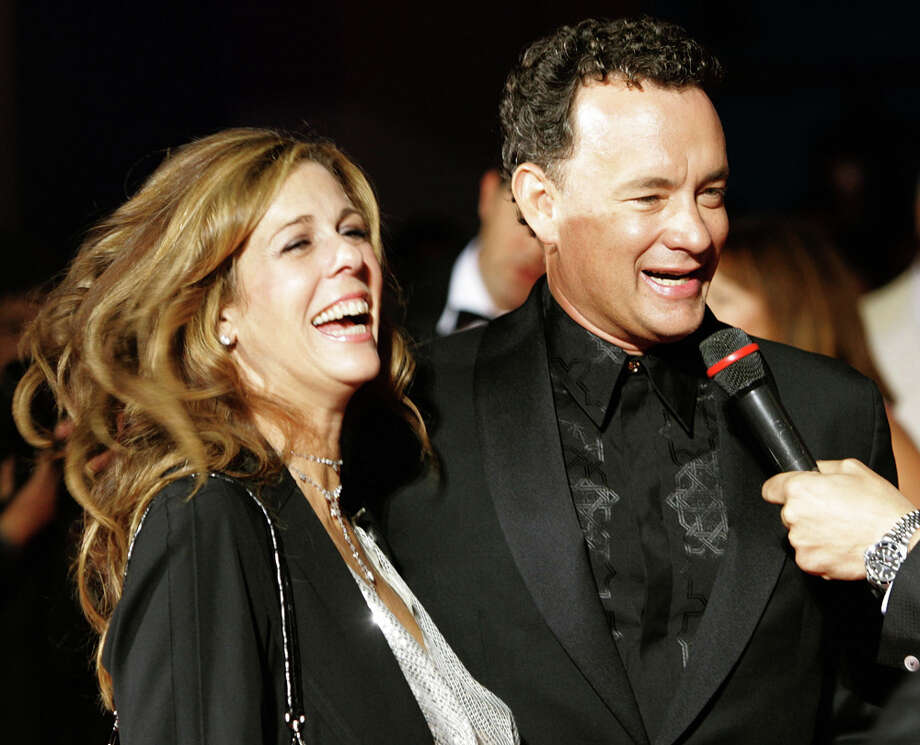 "Rita Wilson once told Vanity Fair ""I didn't know what being in love was until I met Tom [Hanks]."" They met on the set of ""Bosom Buddies"" and worked together on the set of the 1985 film ""Volunteers"" – the one where co-star John Candy is a proud Washington State University graduate. Hanks and Wilson married in 1988 after both ended other relationships, and have two children together. Wilson was a producer for ""My Big Fat Greek Wedding,"" which became the highest-grossing independent film after she helped make the film happen. After Hanks won his second Best Actor Oscar for ""Forrest Gump,"" he told the millions of people watching, ""I'm standing here because the woman I share my life with has taught me and demonstrates to me every day just what love is."" Photo: AP/seattlepi.com File"