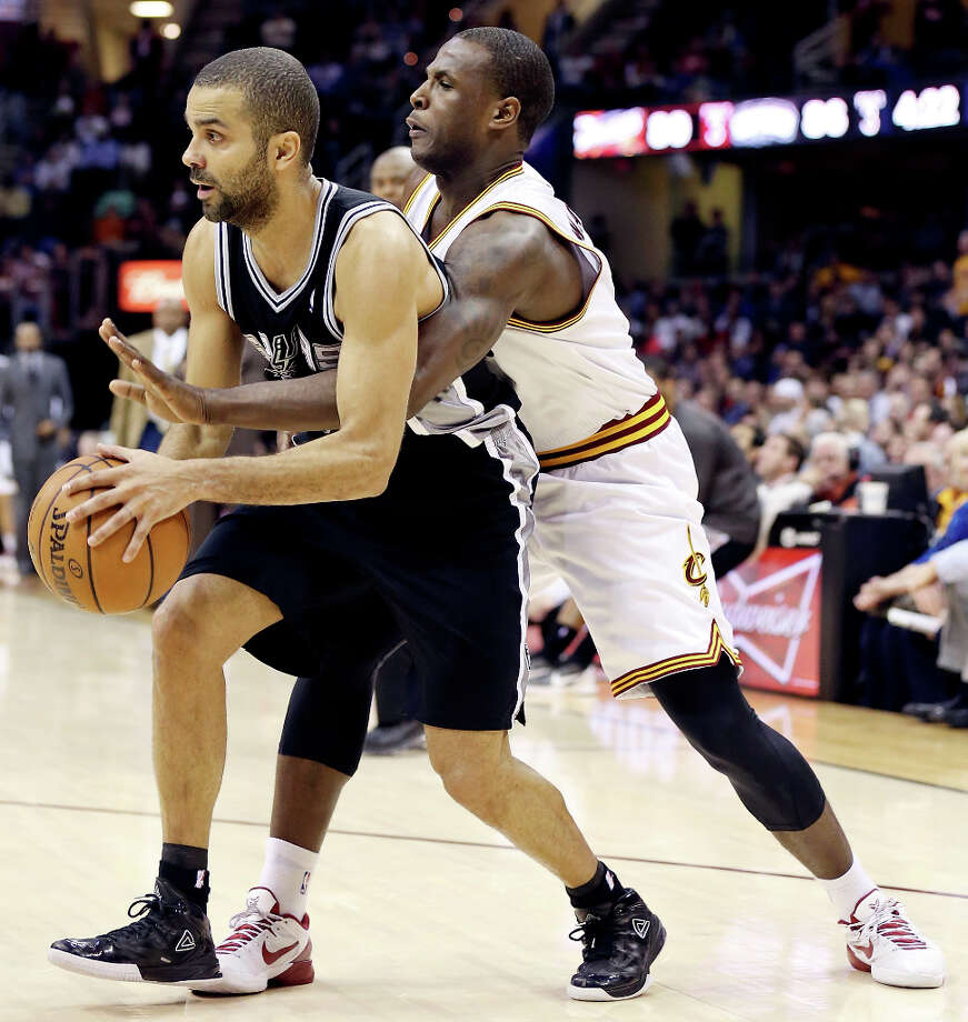The Spurs' Tony Parker looks for room around Cleveland Cavaliers' Dion Waiters during second half action Wednesday, Feb. 13, 2013, at the Quicken Loans Arena in Cleveland, Ohio. The Spurs won 96-95. Photo: Edward A. Ornelas, San Antonio Express-News / © 2013 San Antonio Express-News