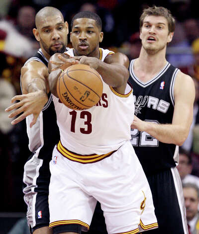 The Spurs' Tim Duncan and San Antonio Spurs' Tiago Splitter defend Cleveland Cavaliers' Tristan Thompson during first half action Wednesday, Feb. 13, 2013, at the Quicken Loans Arena in Cleveland, Ohio. Photo: Edward A. Ornelas, San Antonio Express-News / © 2013 San Antonio Express-News