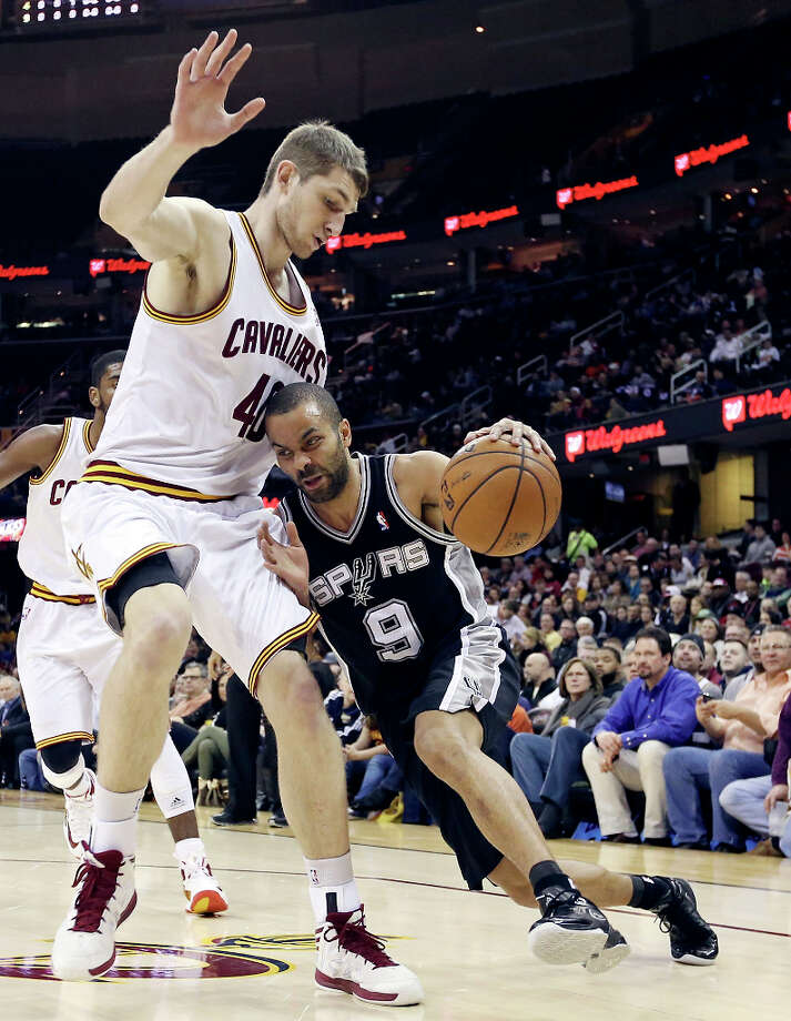 The Spurs' Tony Parker looks for room around Cleveland's Tyler Zeller during first half action Wednesday, Feb. 13, 2013, at the Quicken Loans Arena in Cleveland, Ohio. Photo: Edward A. Ornelas, San Antonio Express-News / © 2013 San Antonio Express-News