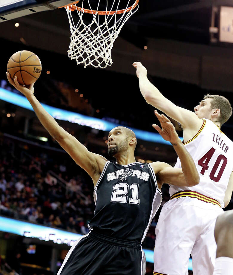 The Spurs' Tim Duncan shoots around Cleveland's Tyler Zeller during second half action Wednesday, Feb. 13, 2013, at the Quicken Loans Arena in Cleveland, Ohio. The Spurs won 96-95. Photo: Edward A. Ornelas, San Antonio Express-News / © 2013 San Antonio Express-News