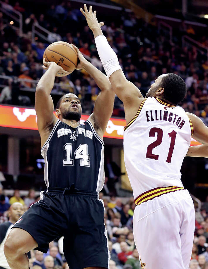 The Spurs' Gary Neal shoots against Cleveland's Wayne Ellington during second half action Wednesday, Feb. 13, 2013, at the Quicken Loans Arena in Cleveland, Ohio. The Spurs won 96-95. Photo: Edward A. Ornelas, San Antonio Express-News / © 2013 San Antonio Express-News