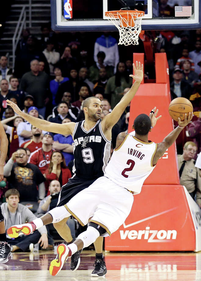 The Spurs' Tony Parker defends Cleveland's Kyrie Irving as he shoots the final shot of the game Wednesday, Feb. 13, 2013, at the Quicken Loans Arena in Cleveland, Ohio. The Spurs won 96-95. Photo: Edward A. Ornelas, San Antonio Express-News / © 2013 San Antonio Express-News