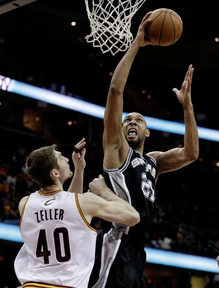 San Antonio Spurs' Tim Duncan (21) shoots over Cleveland Cavaliers' Tyler Zeller (40) during the fourth quarter of an NBA basketball game Wednesday, Feb. 13, 2013, in Cleveland. San Antonio won 96-95. Photo: Tony Dejak, Associated Press / AP