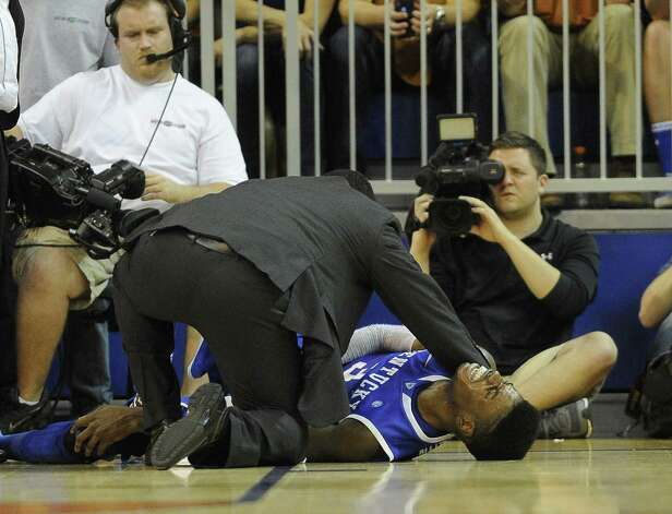 Kentucky's Nerlens Noel grimaces in pain after suffering a torn ACL on Tuesday against Florida. He's out for the season. Photo: Phil Sandlin / Associated Press